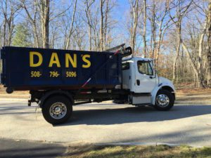 photo of Dan's Dumpster delivery truck in Millbury MA