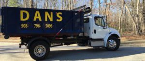 photo of a dumpster rental truck delivering a dumpster in Leicester MA