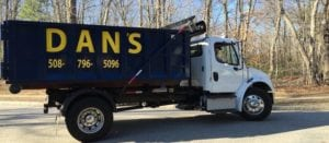 photo of a dumpster rental delivery truck in Charlton MA