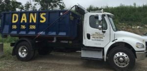 photo of Dan's Dumpster Truck delivering a dumpster rental in Clinton MA