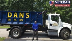 photo of Dan's Dumpsters Delivery Truck and owner Dan