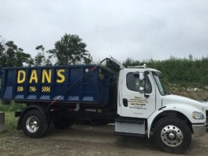 photo of a dumpster rental truck serving Oxford MA
