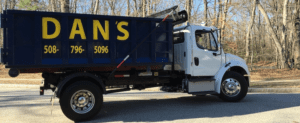 photo of a dumpster rental delivery in Upton MA