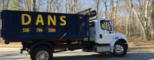 photo of a dumpster rental delivery in Webster MA